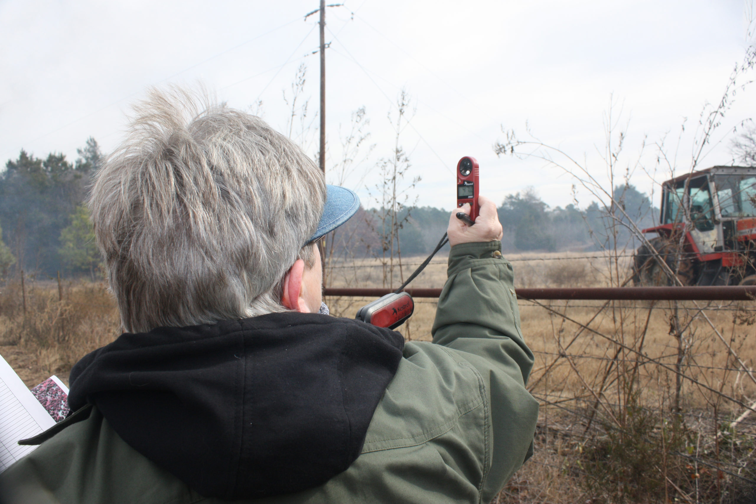 Member of the SCTPBA monitoring the weather during a burn