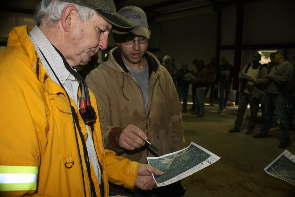 Members of the South Central Texas Prescribed Burn Association reviewing the burn plan map